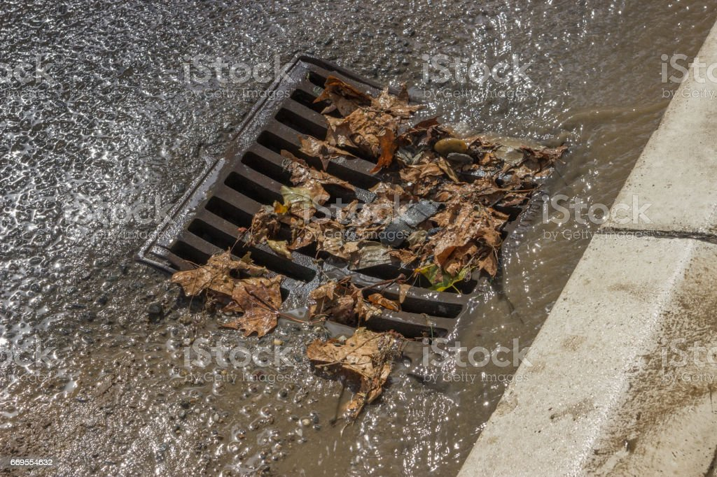 metal storm drain cover after street cleaning stock photo