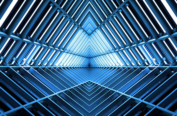 metal structure similar to spaceship interior in blue light - diminishing perspective stock pictures, royalty-free photos & images