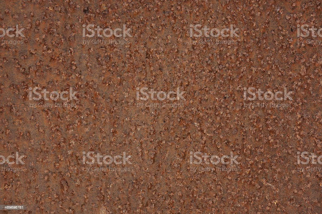 Metal surface is pitted with rust royalty-free stock photo