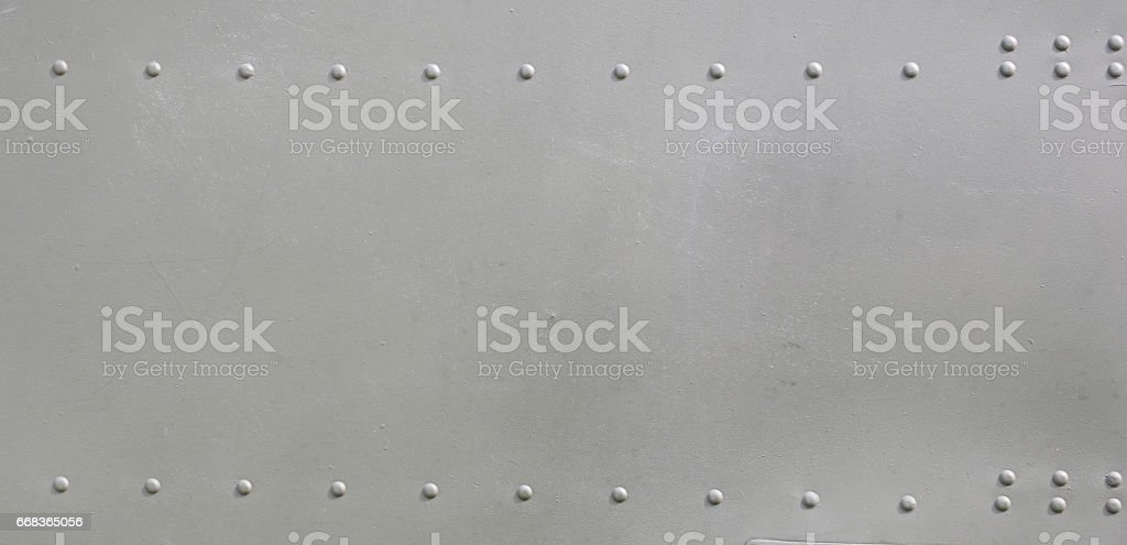 metal surface of military aircraft stock photo