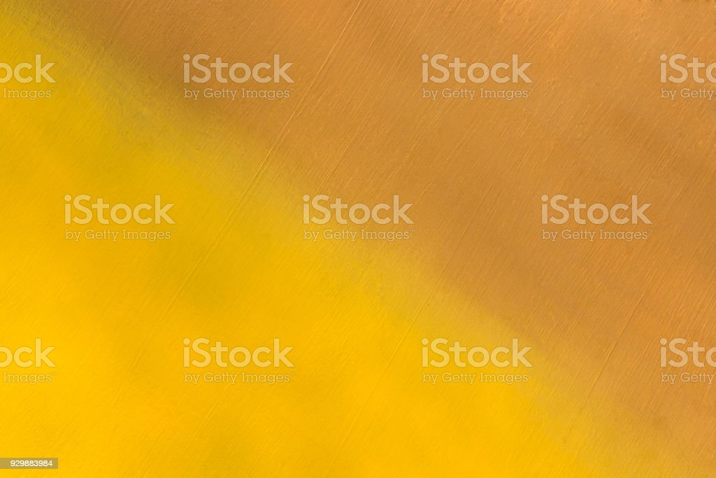 metal surface painted in yellow and brown color stock photo