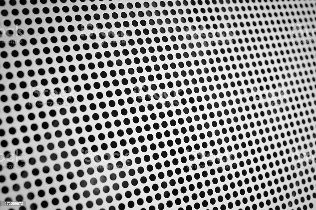 metal surface with holes royalty-free stock photo
