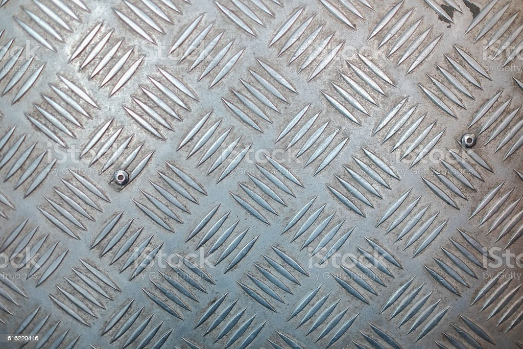 Metal surface with non-slip pattern stock photo
