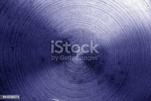 938345942 istock photo Metal surface with scratches in blue tone. 944536374