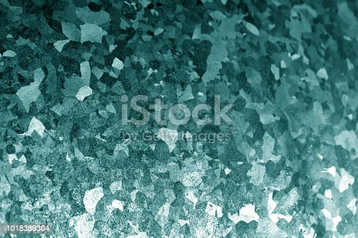 istock Metal surface with scratches in cyan tone 1018389304