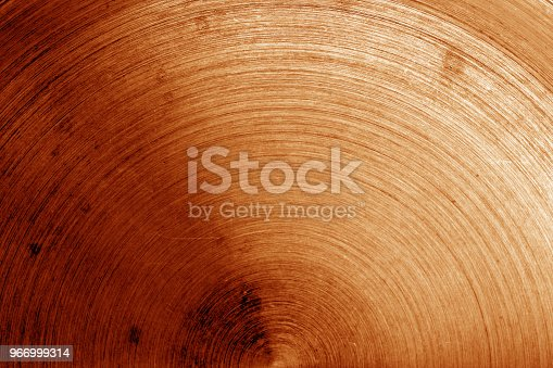 938345942 istock photo Metal surface with scratches in orange tone 966999314
