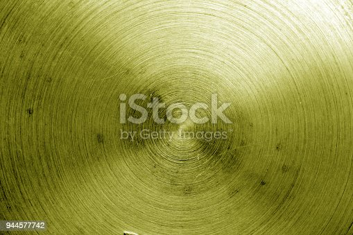 938345942 istock photo Metal surface with scratches in yellow tone. 944577742