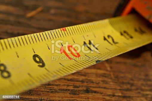 istock Metal tape meter with red and black numbers 639355744