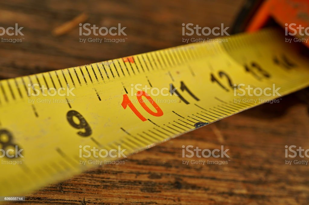 Metal tape meter with red and black numbers stock photo