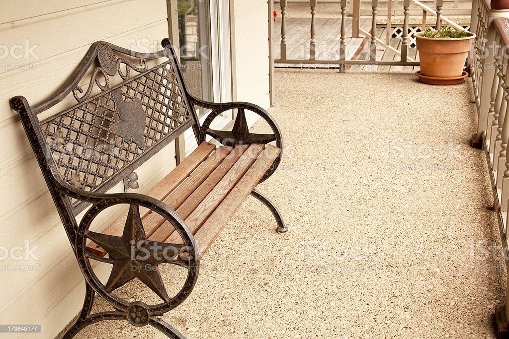 Metal Texas bench on a porch. stock photo