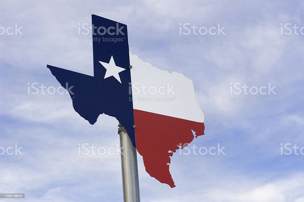 Metal Texas road Sign against sky. stock photo