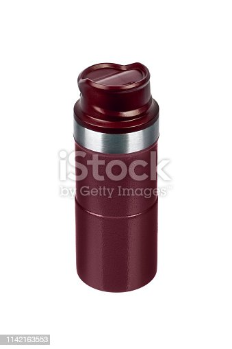 1135476970istockphoto Metal thermos isolated on white background. Front view of the thermo flask isolated on white. 1142163553
