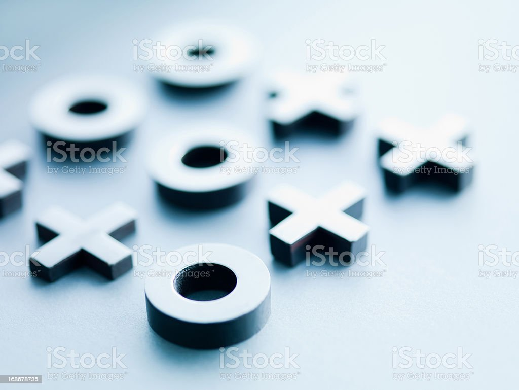 Metal tic-tac-toe game pieces stock photo