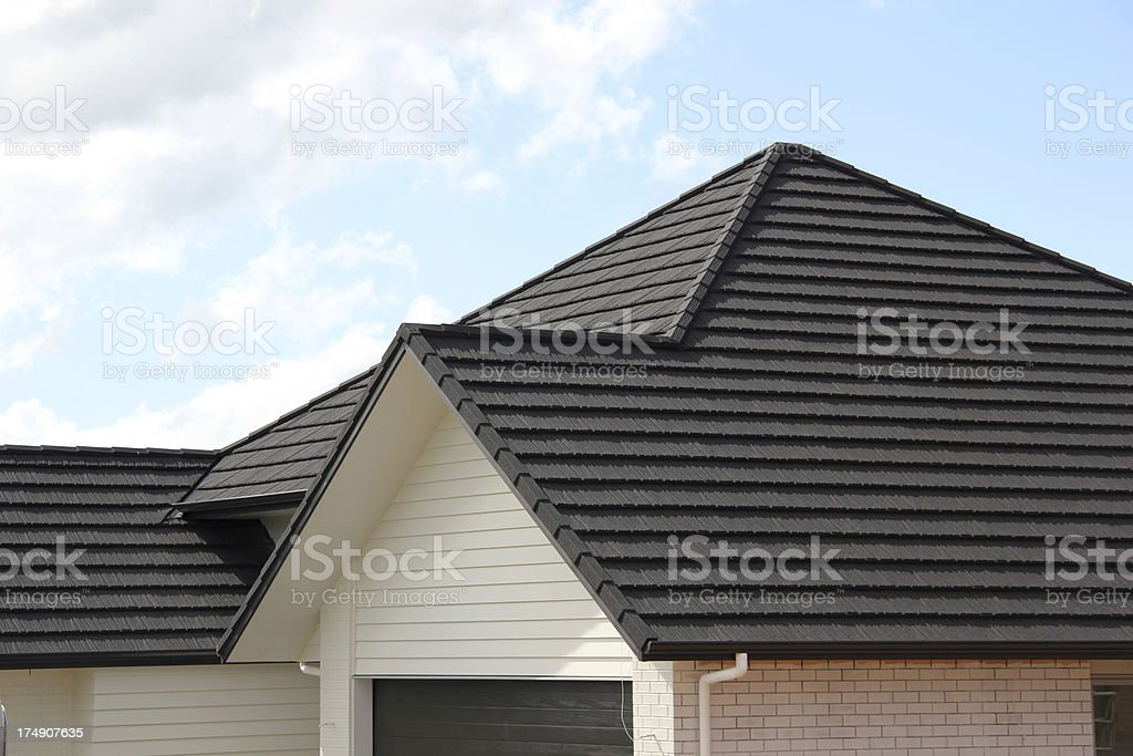 Metal tile roof on new house stock photo
