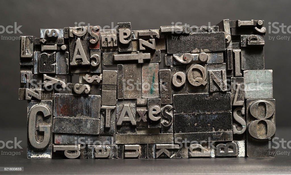 Metal Type Printing Press Typeset Taxes Typography Text Letters stock photo
