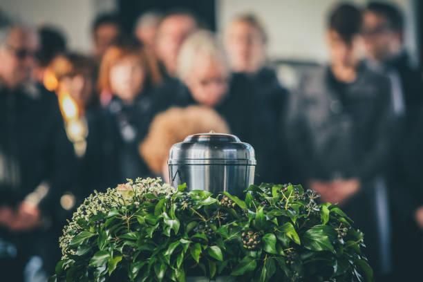 metal urn at a funeral - funerale foto e immagini stock