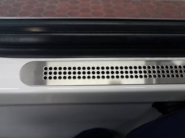 metal vent with holes near window on public train transportation stock photo