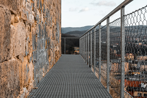 Metal truss platform for tourists next to the fortress wall in Klodzko. Southwestern Poland.