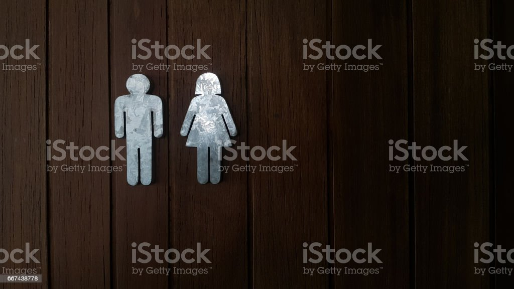 Metal vintage toilet sign on wooden door stock photo