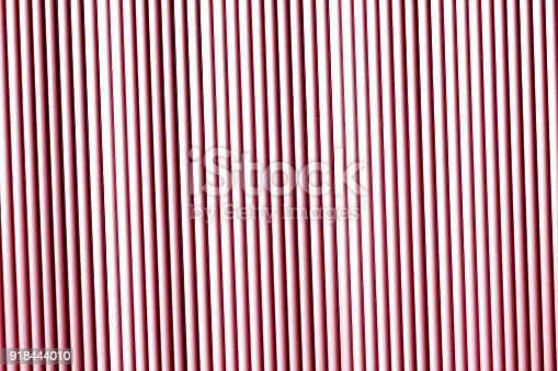 istock Metal wall texture in red tone. 918444010