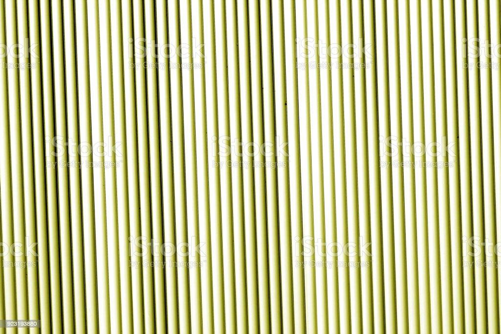 Metal wall texture in yellow tone. stock photo