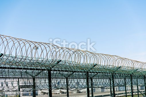Metal wall with barbed wire.