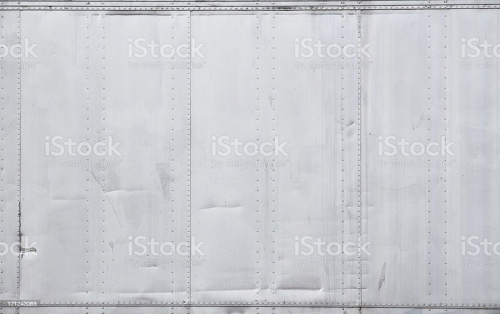 Metal Wall with Rivets Background stock photo