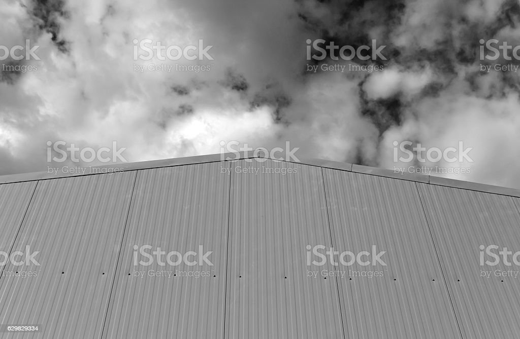 Metal warehouse building wall in black and white stock photo