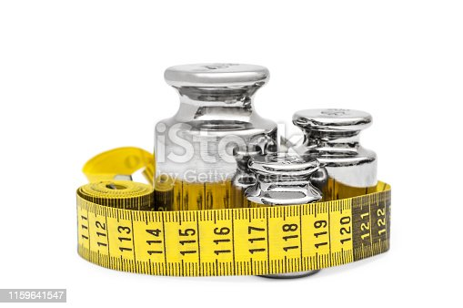 istock Metal weights with measuring tape on white. 1159641547
