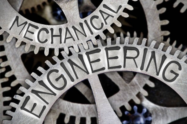 Metal Wheel Concept Macro photo of tooth wheel mechanism with MECHANICAL ENGINEERING letters imprinted on metal surface mechanical engineering stock pictures, royalty-free photos & images