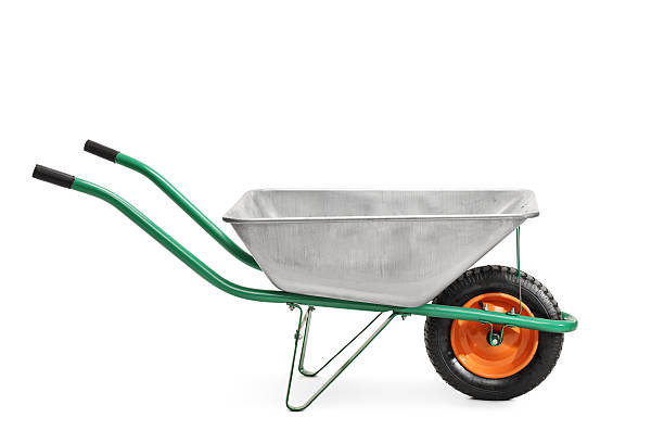 metal wheelbarrow with green handles - kruiwagen stockfoto's en -beelden