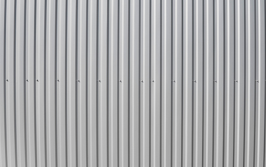 Metal white sheet for industrial building and construction on blue sky background. Roof sheet metal or corrugated roofs of factory building or warehouse