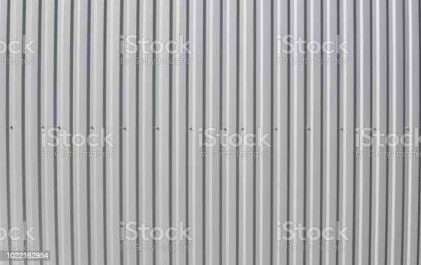 Photo of Metal white sheet for industrial building and construction. Roof sheet metal or corrugated roofs of factory building or warehouse.
