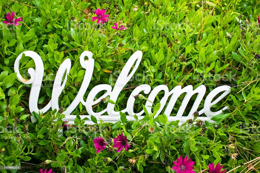 Metal White Welcome Sign On Flower Background Stock Photo ...
