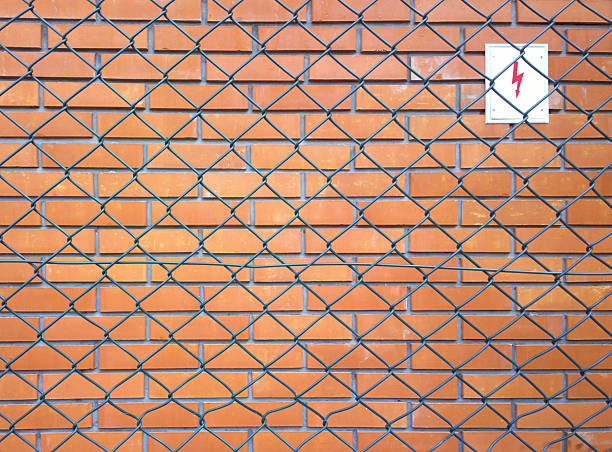 Metal wire and brick wall stock photo