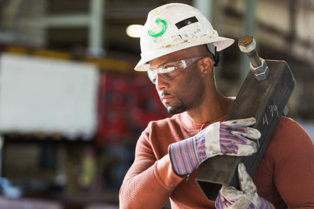 Metal worker in fabrication plant stock photo