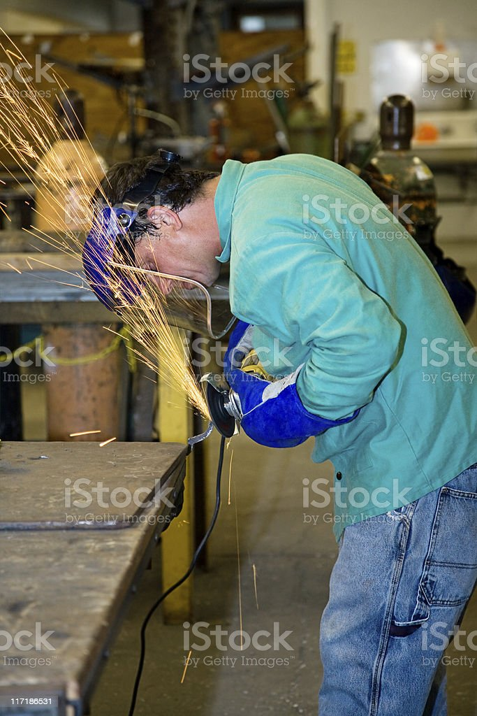 Metal Worker Using Grinder royalty-free stock photo
