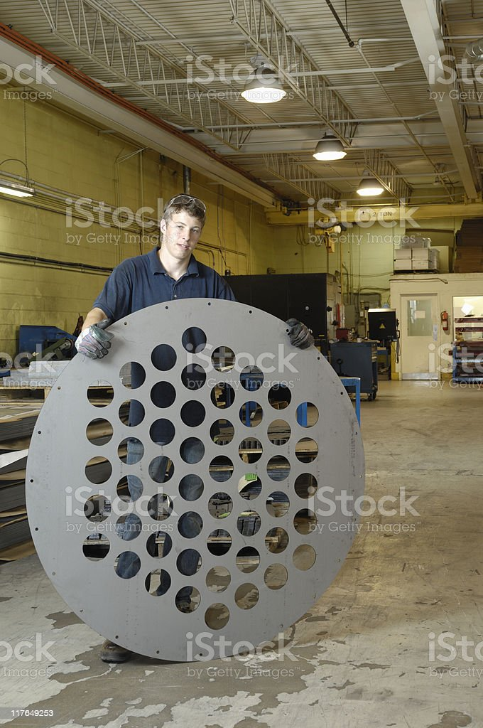 Metal worker with large manufactured component royalty-free stock photo