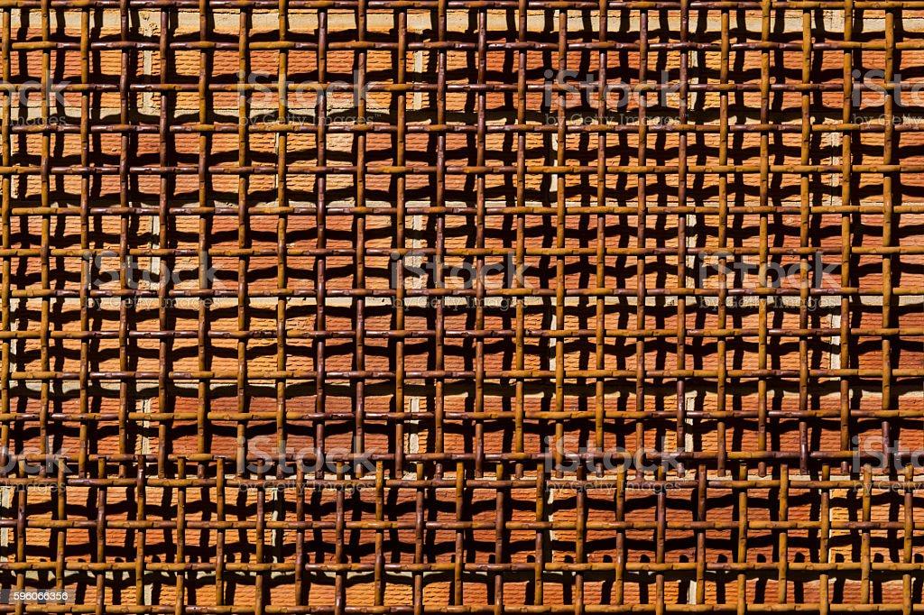 Metal Woven Mesh Screen Over Brick Wall royalty-free stock photo