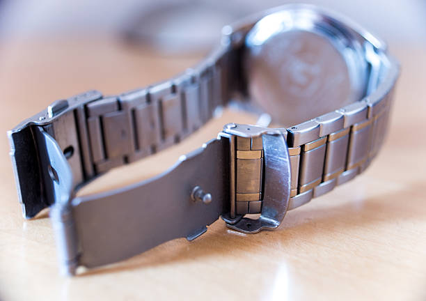 Metal Wristwatch on a Table stock photo