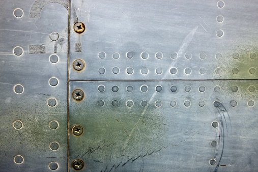 airplane metal texture with screws and rivets