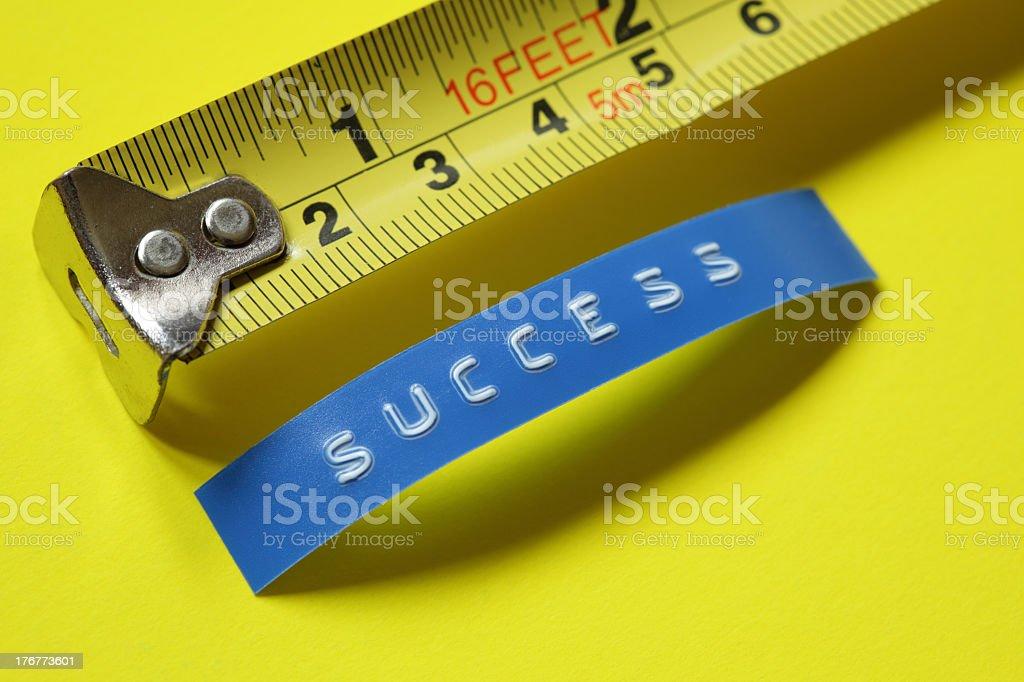 Metal yellow ruler measuring success stock photo
