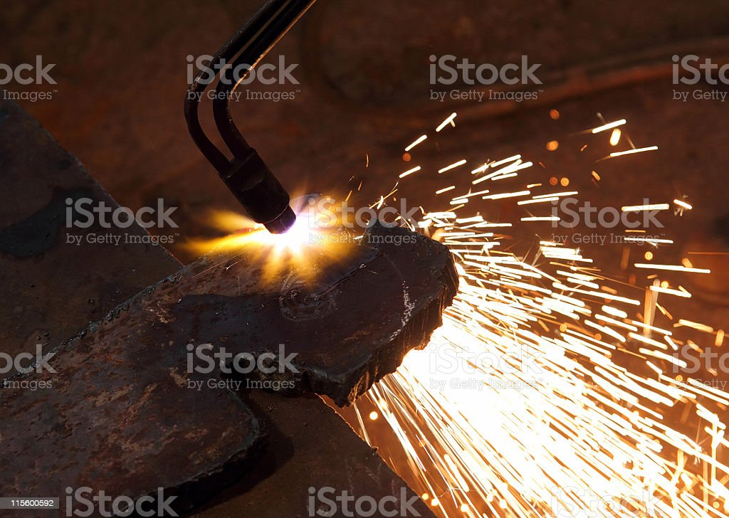 metall detail cutting with acetylene welding close-up
