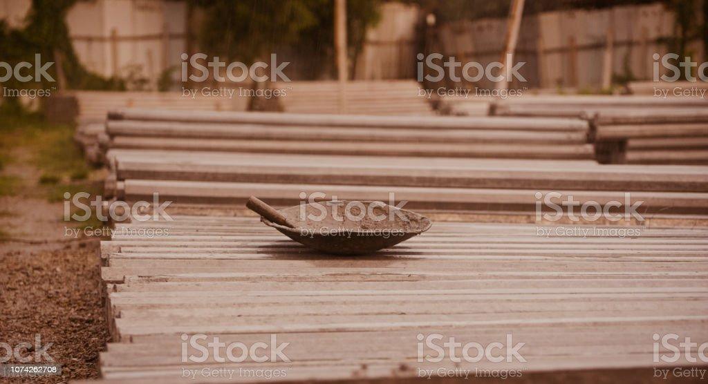 A metallic bowl around aconstruction site stock photo