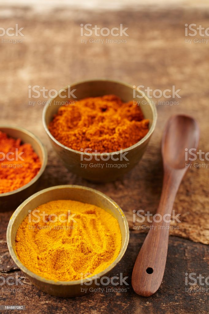 Metallic bowls with turmeric and sandalwood powder royalty-free stock photo