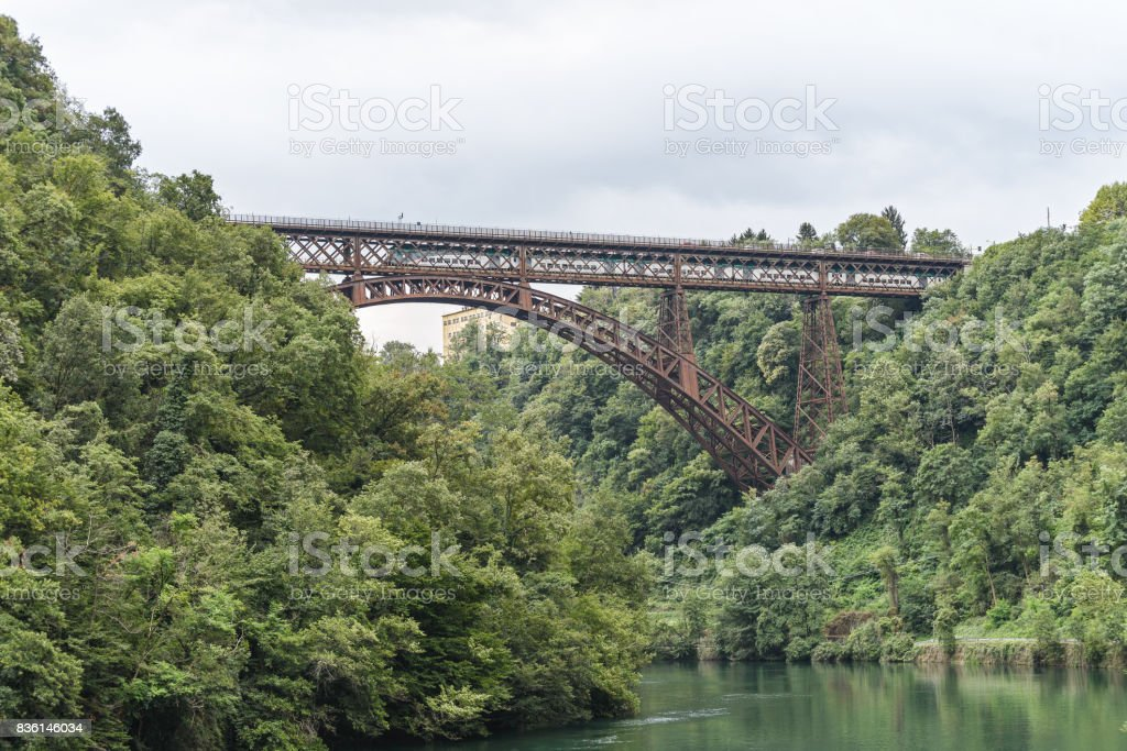 metallic bridge over Adda River stock photo