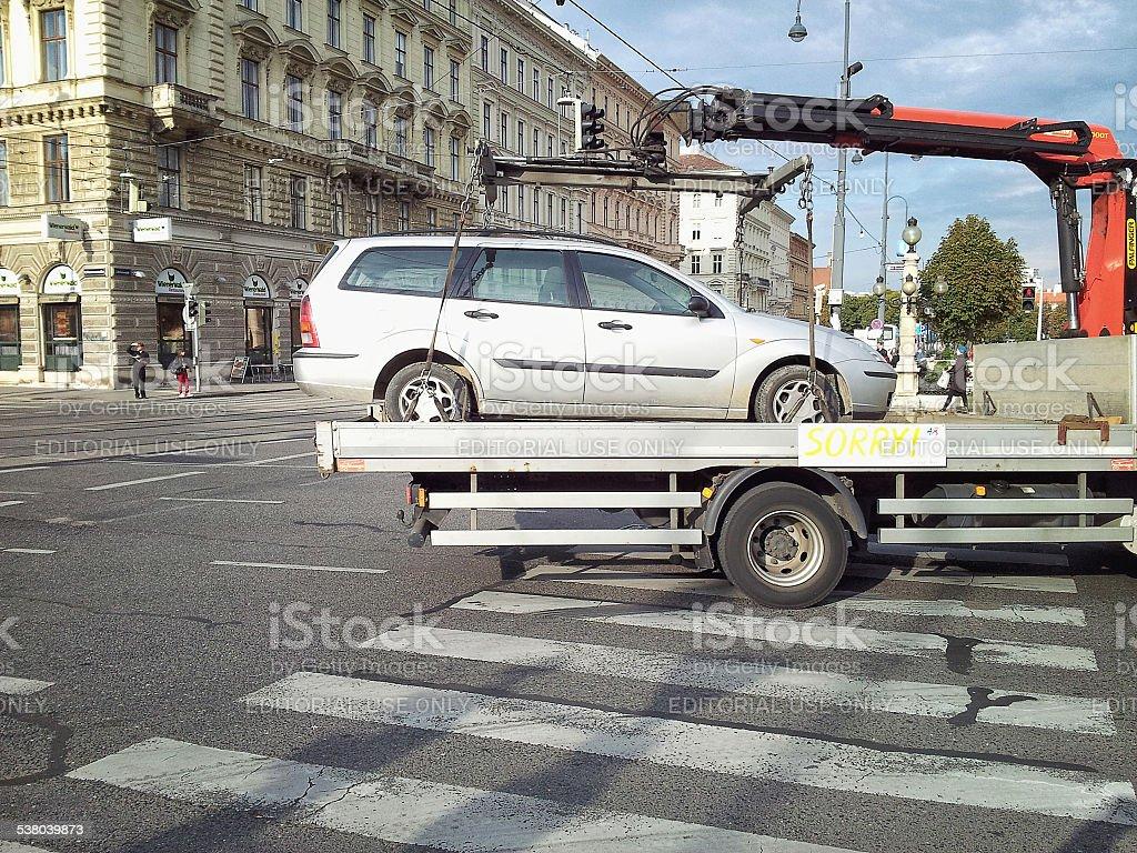 Metallic car is taken away in Vienna stock photo