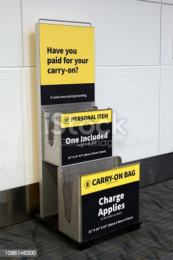 Metallic carry on luggage and personal item sizer at airport gate