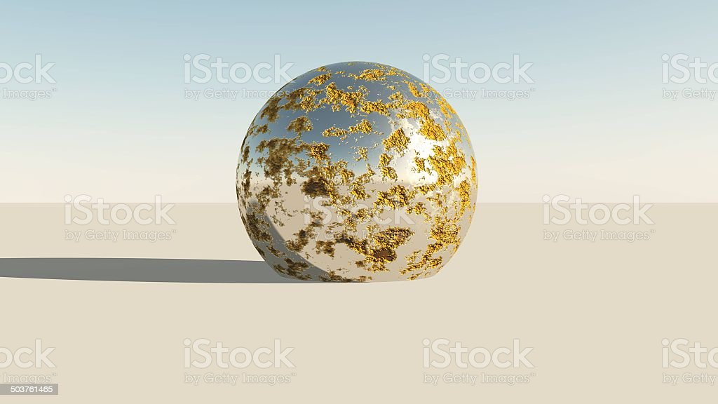 Metallic chrome sphere in desert stock photo