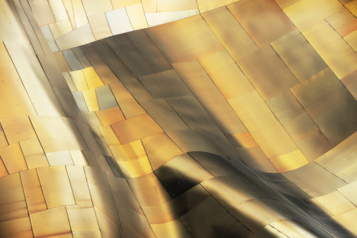 Metallic art abstract wave in shiny copper silver panels.